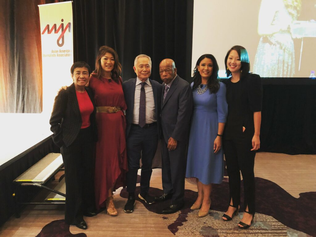 Maria Ressa at the AAJA 2019 Convention in Atlanta, Georgia, standing with from left to right, Juju Chang, George Takei, the late Congressman John Lewis, Elaine Quijano, and Michelle Ye Hee Lee.